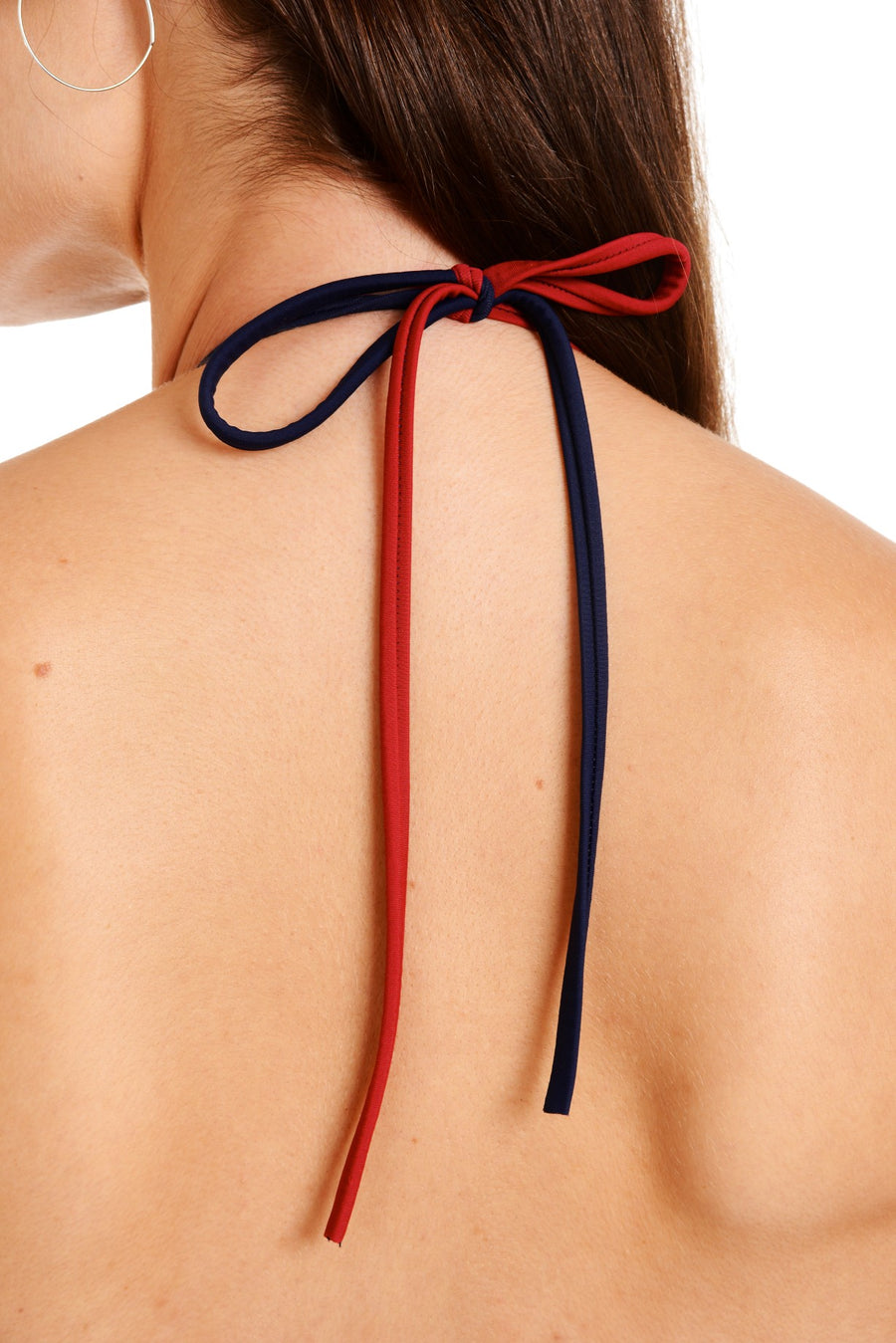 Close up back view of dark blue one piece adjustable straps