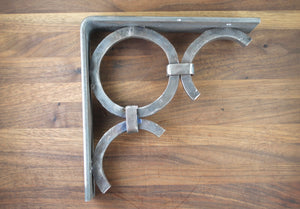These circular designed Corbels are completely hand forged. Made of solid steel, they work great for mantles, shelves, beams, counters and much more. ~ RedRiverIron.com