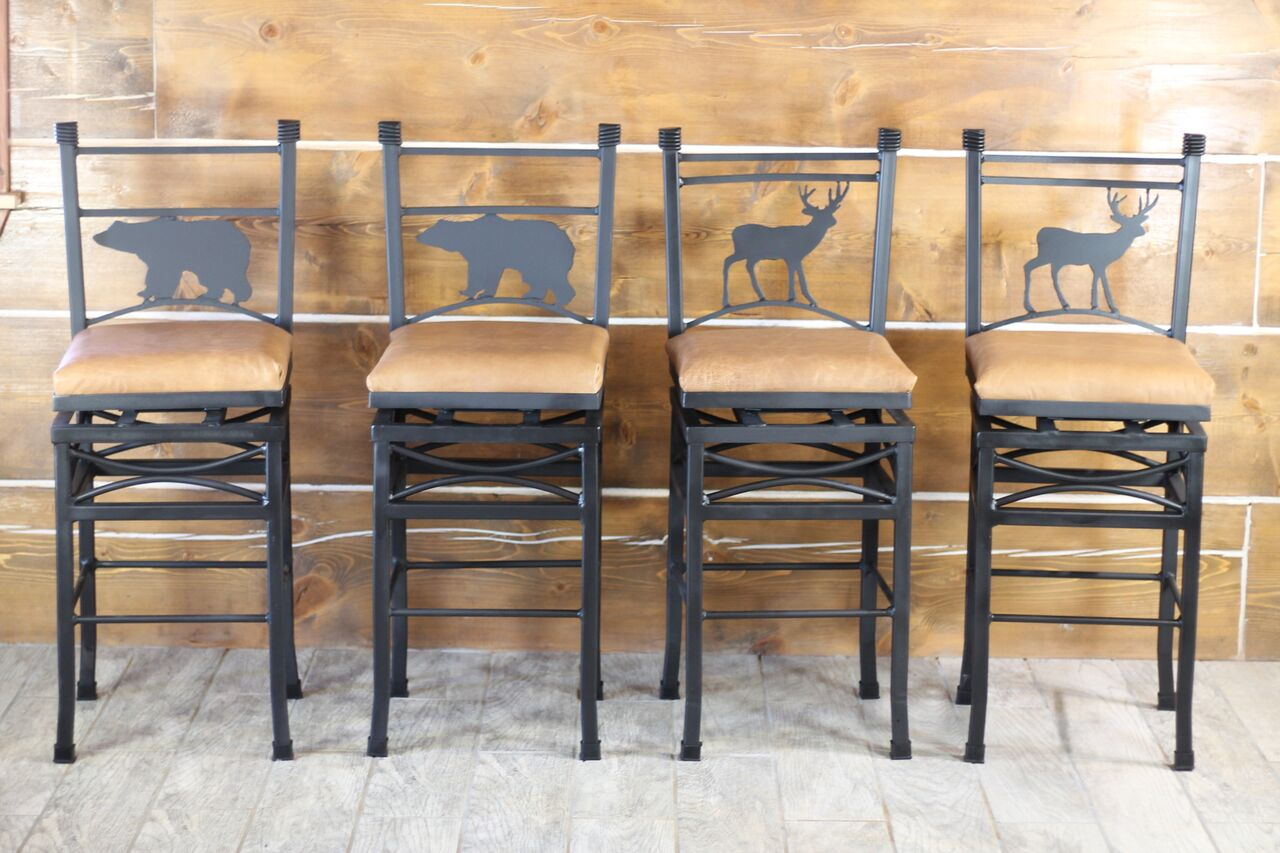 Wilderness Swivel Bar Stools ~ Counter Height, features Bear or Deer cut out. Genuine Leather Seat.  Hand crafted by our in house blacksmith. Adds a cabin feel to any kitchen or bar area.  RedRiverIron.com