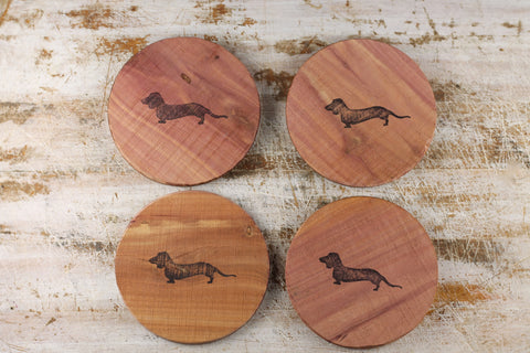 Natural aromatic cedar drink coasters with dachshund design. Naturally absorbent cedar that is locally sourced. The perfect gift for the dachshund lover on your list. RedRiverIron.com