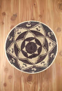 Southwest Basket ~ Handcrafted from tightly woven palm leaves. Cocoa brown design with small dogs and stars.  Perfect to display trinkets or as a centerpiece. FREE SHIPPING RedRiverIron.com
