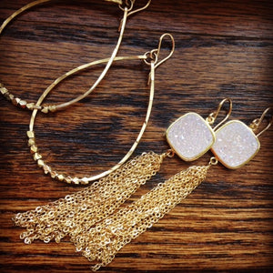 shown next to our Tess Drusy Tassel Earrings