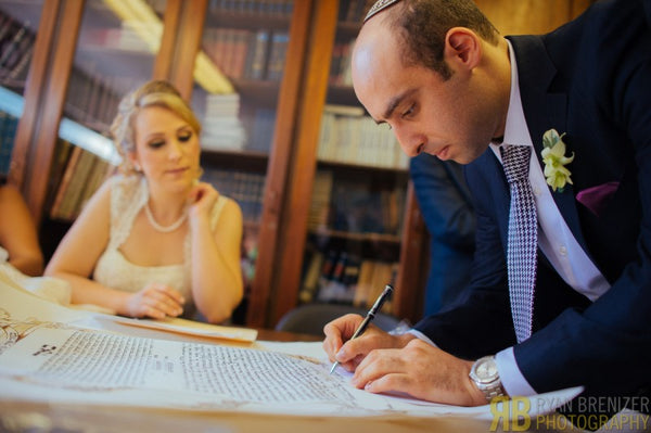 Royal Ketubah signature ceremony close up
