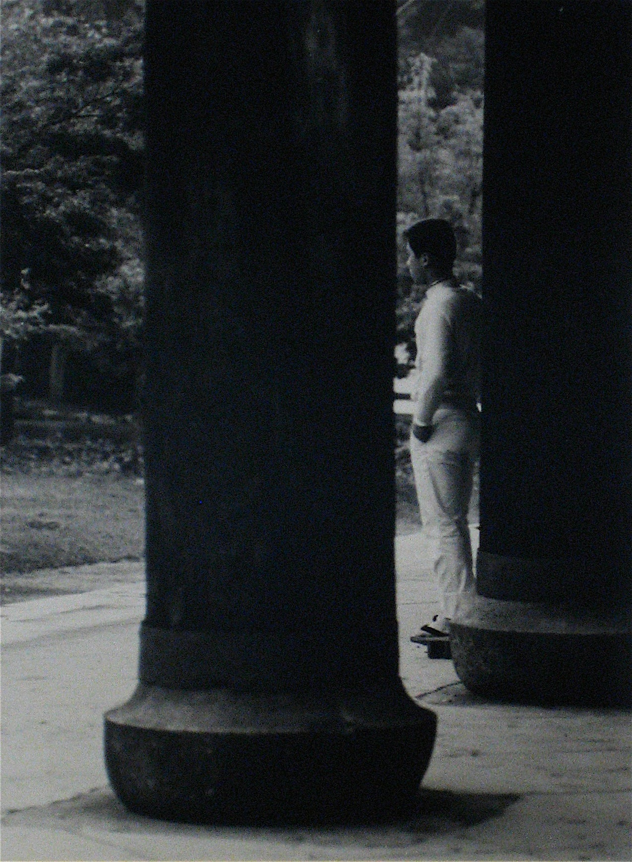 Man Between the Pilars <br>1960s Photograph <br><br>#12263