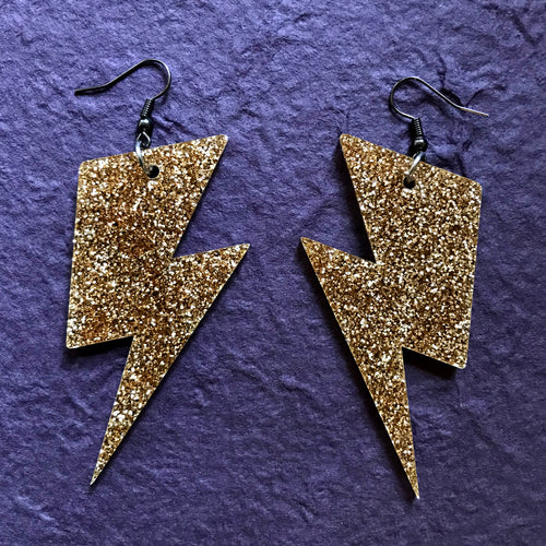 Lightning bolt gold glitter earrings