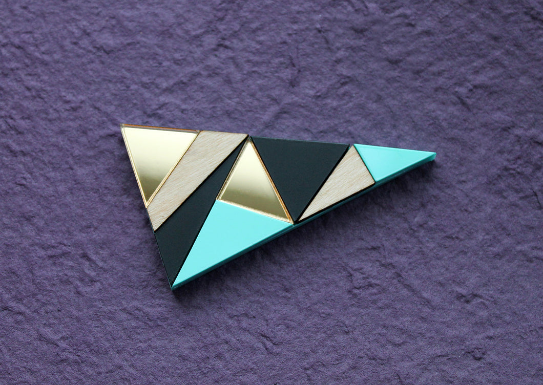 Geometric triangle brooch