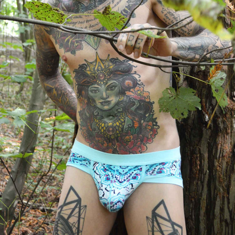 The Keenan Printed Blue Briefs by Super Gay Underwear for men modeled by tattoo'd Matthew Leighton Trew