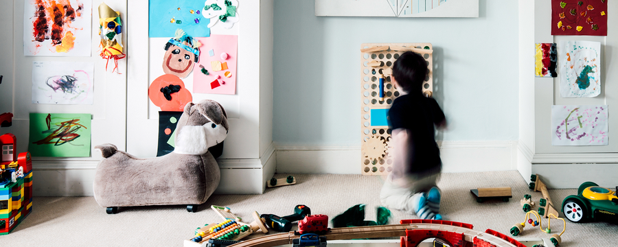 Stylish nursery boy room and kid playing with wooden MURO toys and play centre.