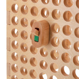 wooden light switch toy on activity board