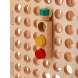 traffic light toy on muro activity board