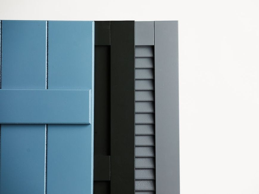 blue board and batten, black flat panel and grey louvered shutters