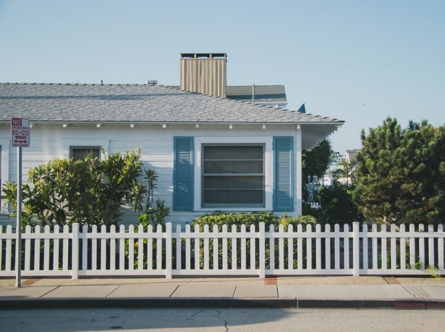 grey bungalow house with blue shutters