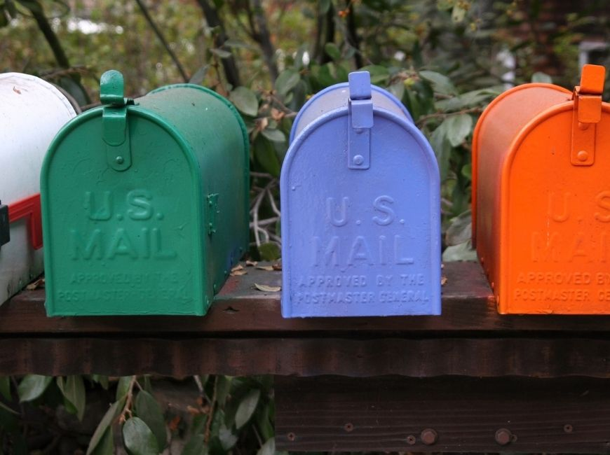 green, purple and orange mailboxes