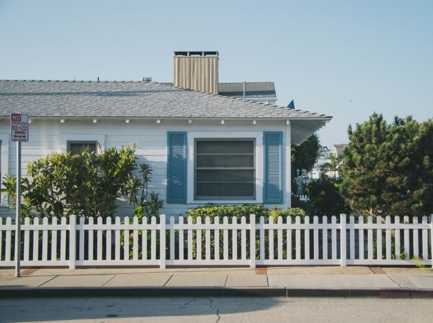 light blue home with blue shutters