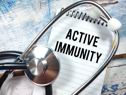 """""""Active Immunity"""" written on note pad with stethoscope"""