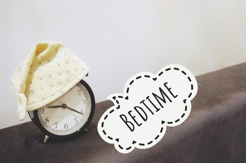 """Alarm clock with hat on it saying """"Bedtime"""""""