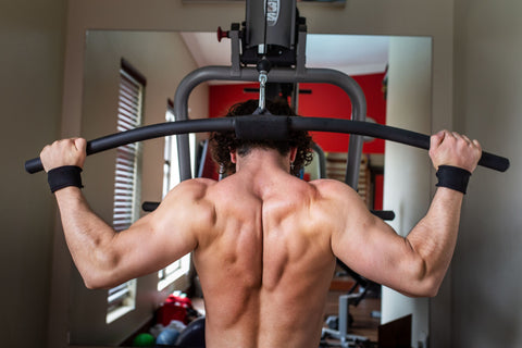 Back view of man doing lat pull down