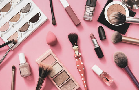 Scatted makeup pallets, brushes, and products