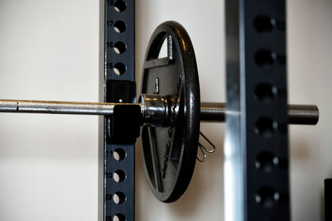 End of a barbell on weight rack