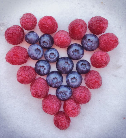 Heart made out blueberries and raspberries