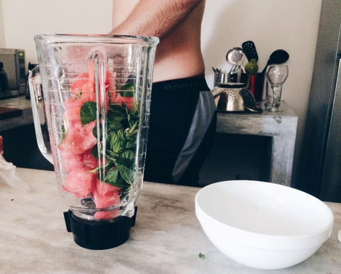 Glass blender filled with watermelon and spinach