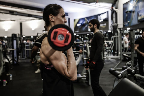Woman preparing for a bodybuilding competition.
