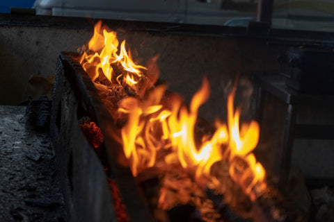 Close up of log burning with red and orange fire