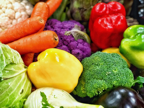Colorful fresh vegetables such as carrots peppers and broccoli
