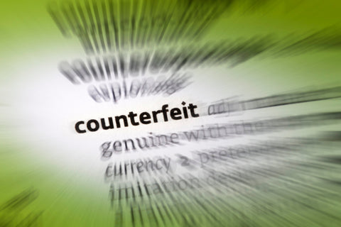 """""""Counterfeit"""" within paragraph of text that is blurred"""