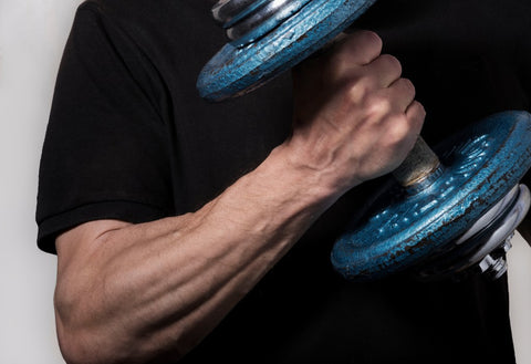 Close up of man curling dumbbell