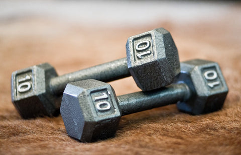 Two ten pound dumbbells on each other