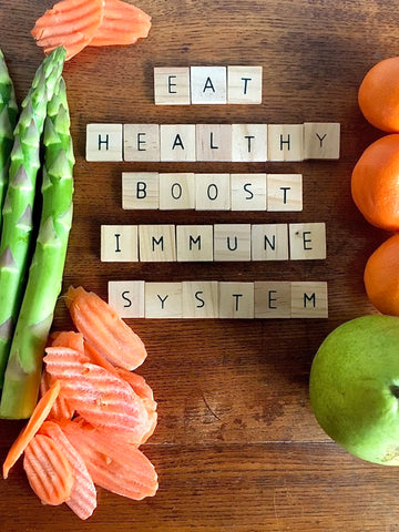 """""""Eat healthy boost immune system"""" with vegetables around it"""