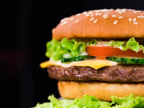 Burger with lettuce, cheese, tomato, and meat