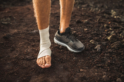 Wrapped hurt foot walking on dirt
