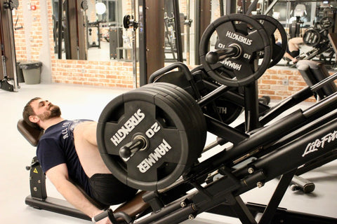 Man in middle of doing free weight leg press
