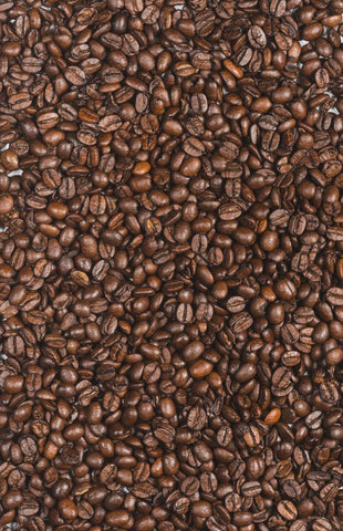 Page covered in green coffee beans