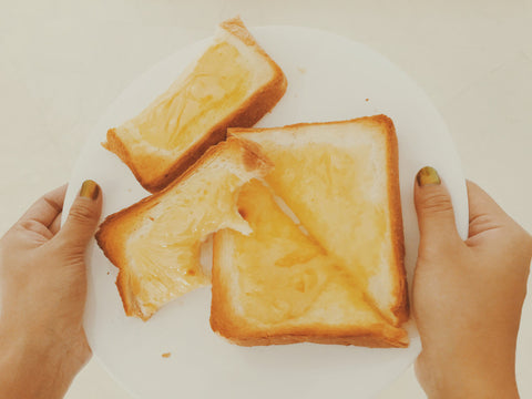 Grilled cheese with bites taken on plate