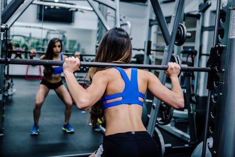 Woman lifting weights at the gym.