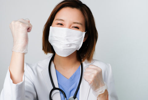 Doctor fit pumping air in joy with mask on