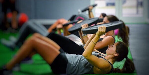 Women working out at the gym.