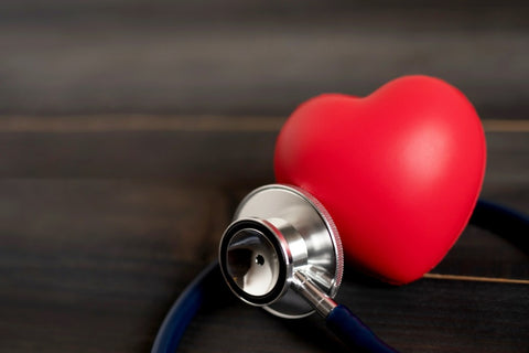 Stethoscope held up to stress heart
