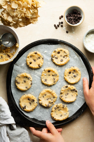 Uncooked chocolate chip keto cookies on a banking pan