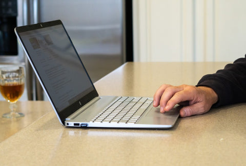 Man typing on laptop doing research