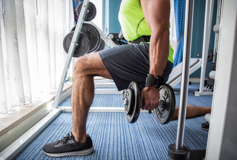 Man doing lunges with weights in both hands