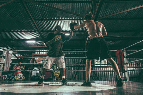 Two men in boxing ring practicing