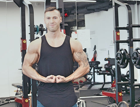 Man flexing arms in front of his body