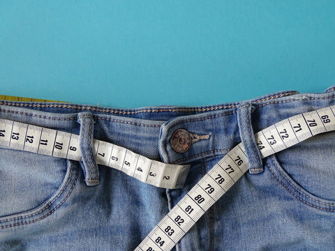 Measuring tape wrapped in pant loops