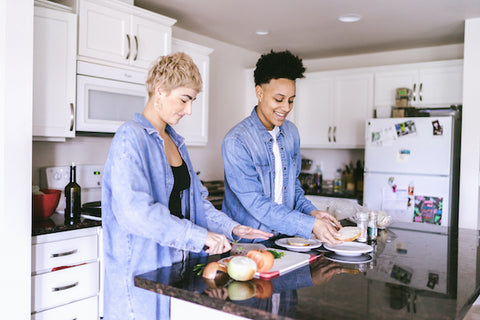 A couple practices mindful eating while cooking dinner