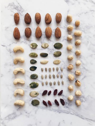 Different types of nuts on a counter forming a rectangle