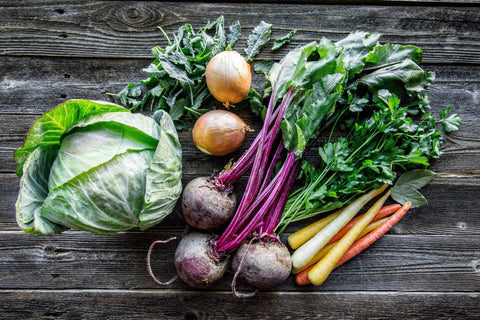 Organic Vegetables on wooden picnic table